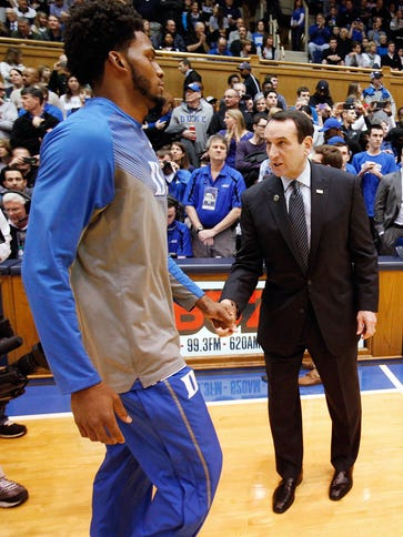Mike Krzyzewski, greeting forward Justise Winslow,