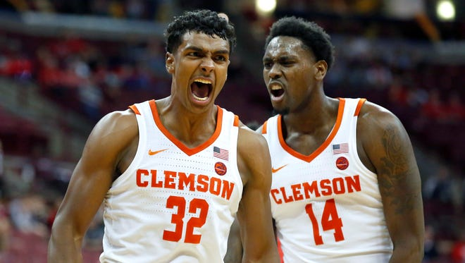 Clemson Tigers forward Donte Grantham (32) celebrates with forward Elijah Thomas (14) after a dunk against the Ohio State Buckeyes during the second half at Value City Arena.