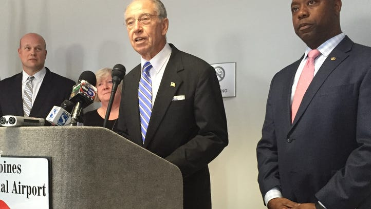 U.S. Sen. Chuck Grassley, R-Iowa, speaks at a news briefing Wednesday, July 20, at the Des Moines airport. On his right is U.S. Sen. Tim Scott, R-South Carolina. On his left is former U.S. Attorney Matt Whitaker and Rev. Lee Schott, a United Methodist clergy member who ministers to inmates at the state women's prison at Mitchellville