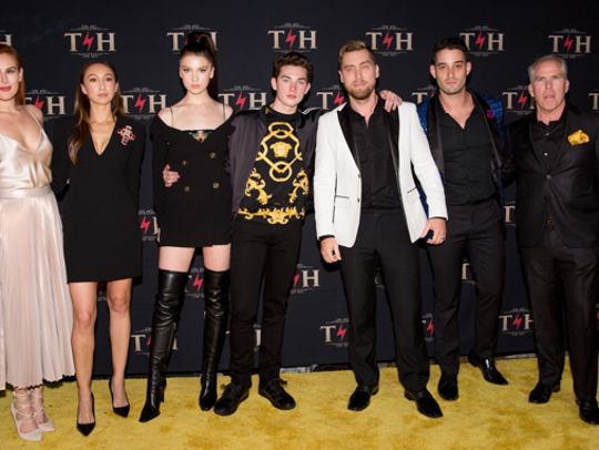 The Henry family stands with Rumer Willis, Lance Bass