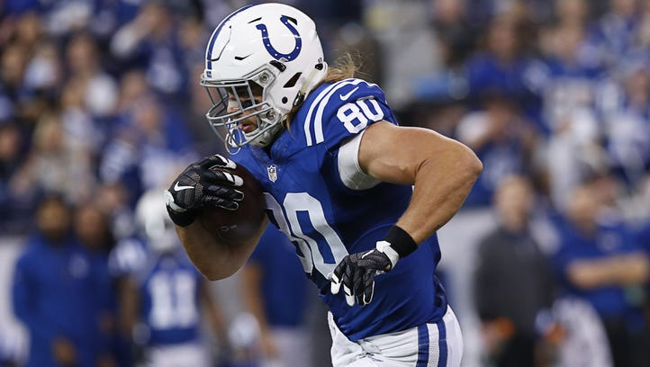 Indianapolis Colts tight end Coby Fleener (80) scores a touchdown on a pass from quarterback Josh Freeman (5) agains the Tennessee Titans at Lucas Oil Stadium on Jan. 3, 2016.
