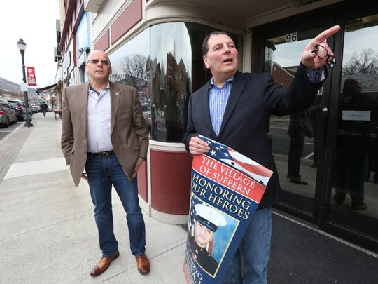 Suffern Mayor Ed Markunas, left, and Aurelius Licata, president of the Greater Suffern Chamber of Commerce, with one of the banners honoring individual veterans which will be placed on a street light poles in the village March 24, 2017.