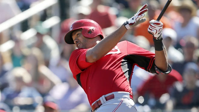 Reds first baseman Chris Dominguez hit an RBI double in the first inning.