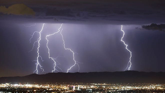 Lightning strikes during a monsoon storm on Tuesday, Aug. 11, 2015 in Phoenix, AZ.