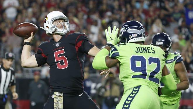 Cardinals' Drew Stanton (5) throws a pass under pressure from Seahawks' Nazair Jones (92) during the first quarter on Nov. 9, 2017 at University of Phoenix Stadium in Glendale, Ariz.