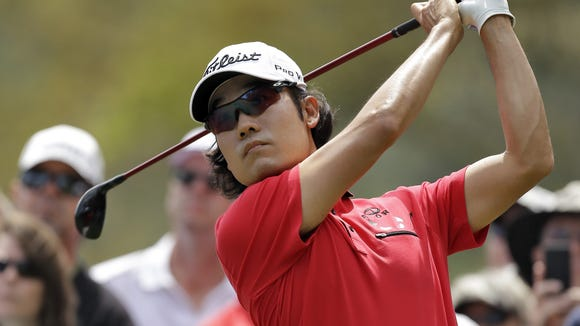 Kevin Na tees off on the second hole during the final round of the Valspar Championship golf tournament at Innisbrook, Sunday, March 16, 2014, in Palm Harbor, Fla. (AP Photo/Chris O'Meara)