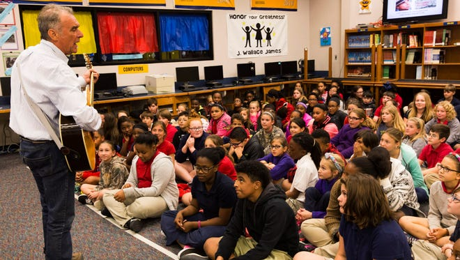 Musician and author Zachary Richard performs for students at J. Wallace James Elementary in March 2016. The school, which has an arts and technology academy, is one of the most popular magnet academies in Lafayette Parish.
