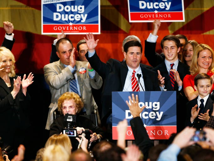 Rob Schumacher/The Republic Republican Doug Ducey celebrates