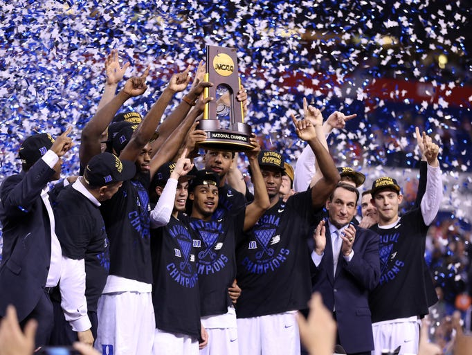 The Duke Blue Devils celebrate with the championship