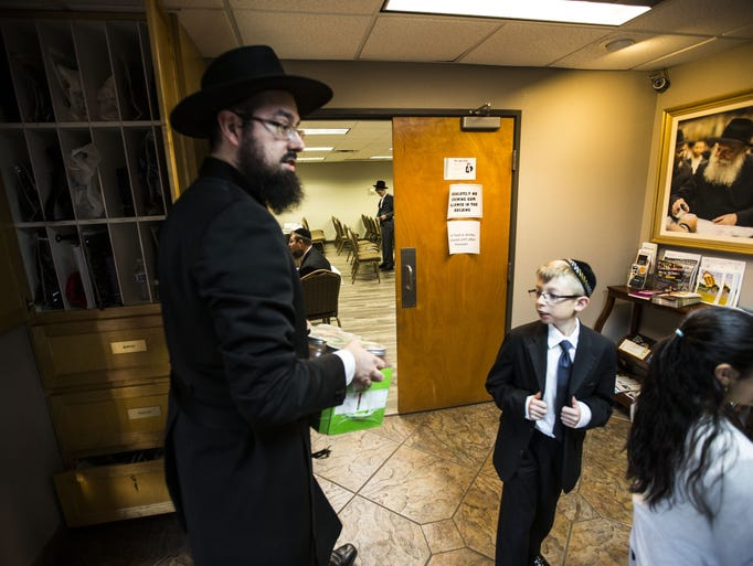 Yehoshua Bedrick heads into an afternoon prayer service