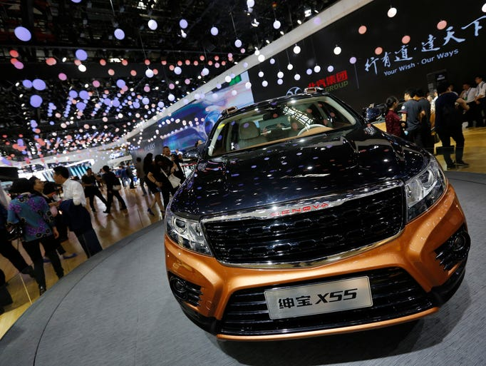 Visitors tour near the Chinese automaker BAIC X55 SUV