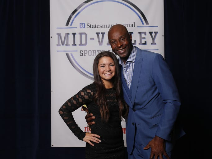 Ashton Phillips of Scio with Jerry Rice at the Mid-Valley