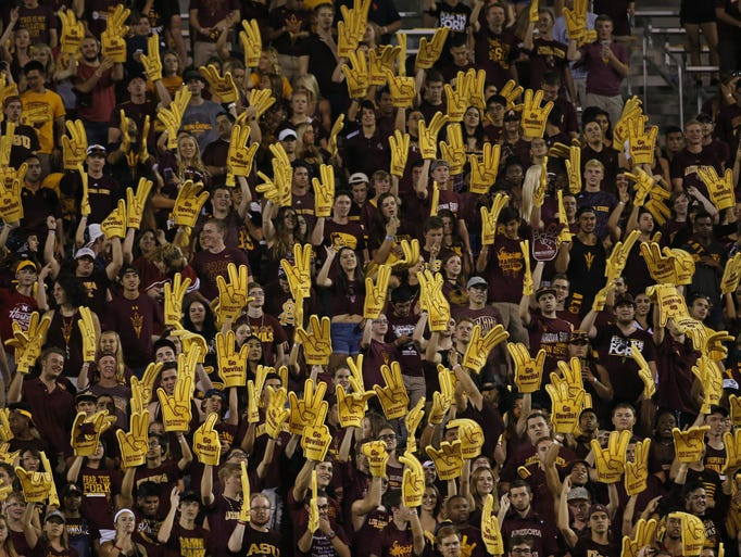 ASU fans throw up the forks during the first half at