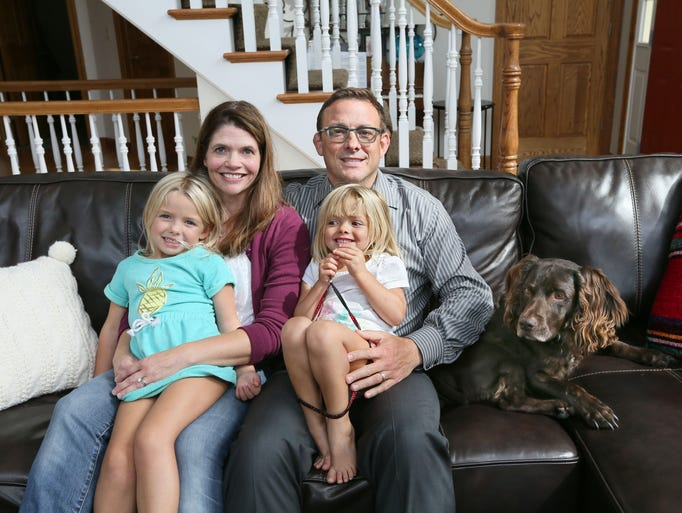 Jodi (left) and Paul Brehm and their children, Reese,