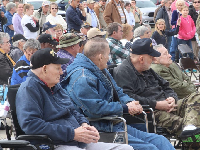 World War II veterans in the from row of the Veterans