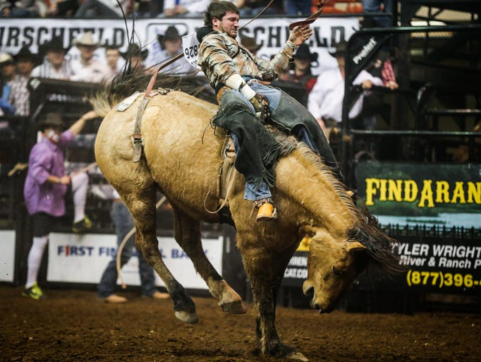 Chad Rutherford rides bareback during the 11th performance