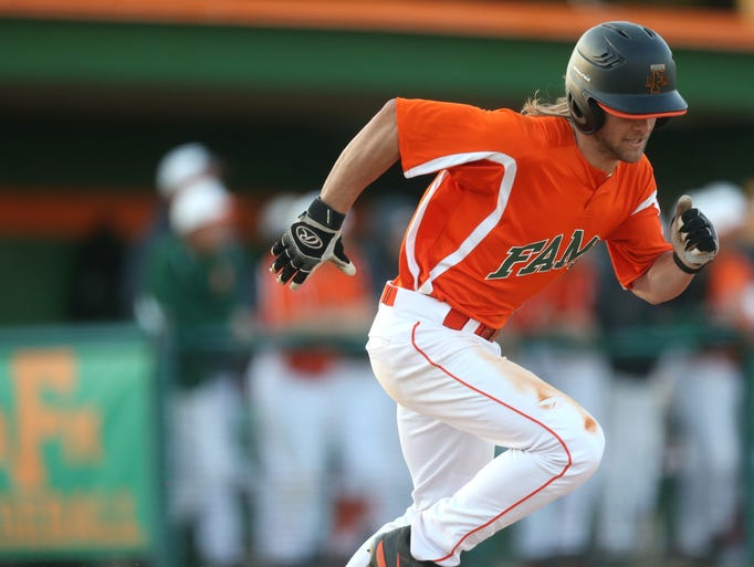 FAMU's John Capra takes off for first base during their