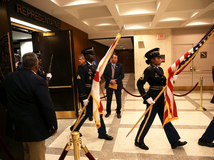 The Color Guard marches out of the House of RepresentativesÕ