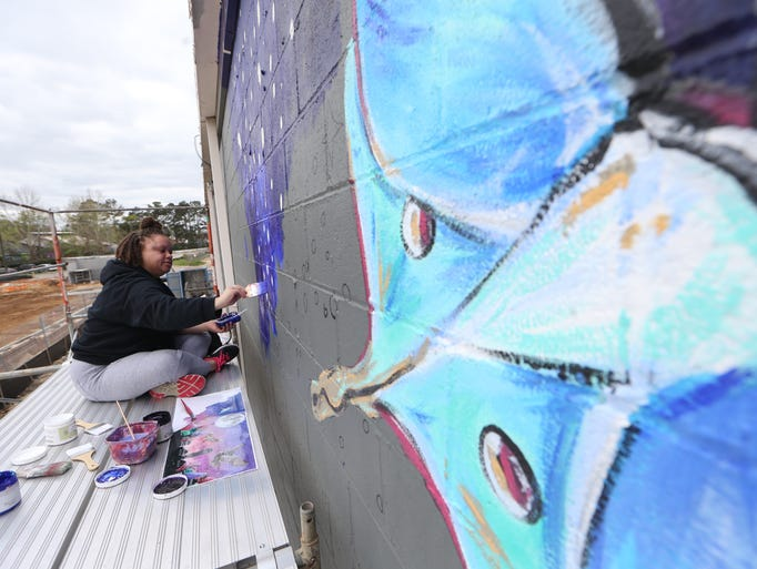 Simone Wilson, an art therapy major at FSU, works on