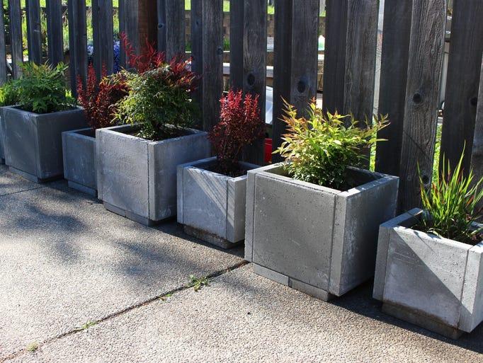 Create economical patio planters with concrete pavers.