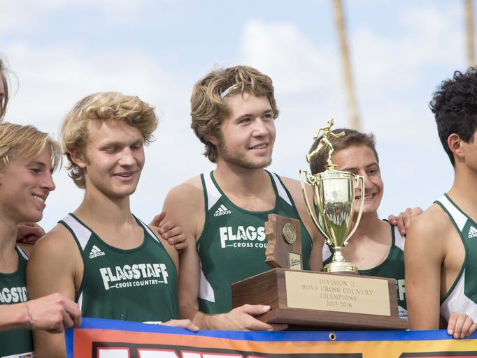 Flagstaff High School holds a First place team trophy