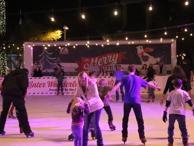 Skaters try out the ice at the Winter Wonderland Ice