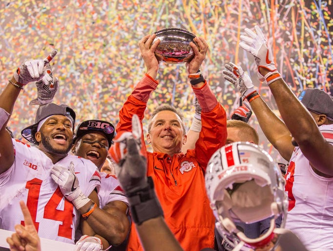 Ohio State Buckeyes head coach Urban Meyer holds up