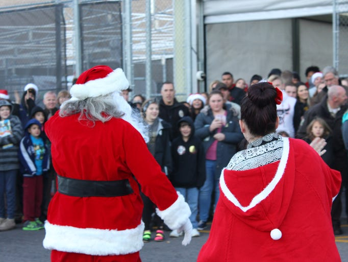 Santa Clause arrives at Walmart in Cedar City for the