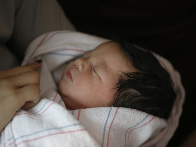 Daisy Villalobos holds her and Marcelo Encheverria's