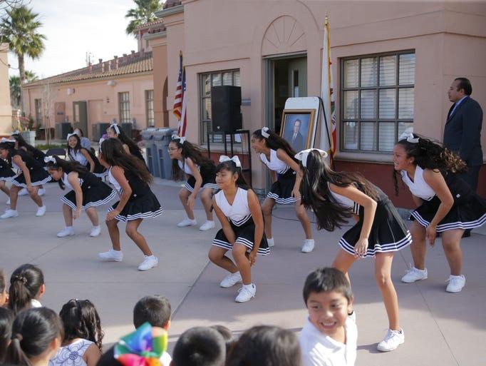 Cheerleaders perform for Jesse G. Sanchez's birthday.
