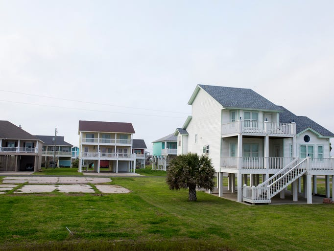 A empty slab sits next to a new beach house on Saturday,