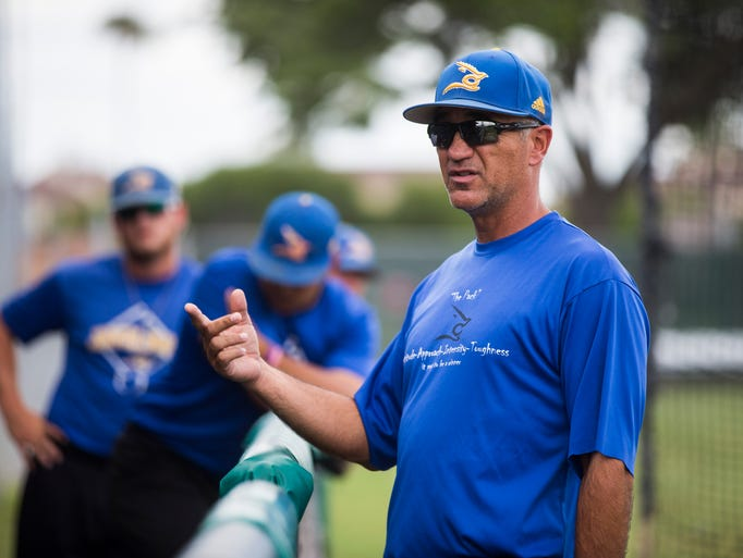 Texas A&M-Kingsville coach Jason Gonzalez speaks with