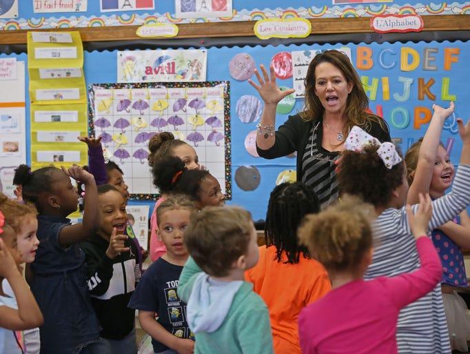 Teacher Dawn Balistreri works with K-4 students at