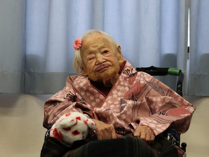 Misao Okawa, the world's oldest Japanese woman, poses