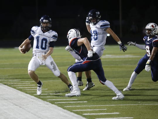 Lewis Central's Max Duggan gets a first down on a fake punt during the Urbandale vs Lewis Central football game held at Urbandale Friday night.  This was Urbandale's Homecoming game.  (Special to the Register/Conrad Schmidt)