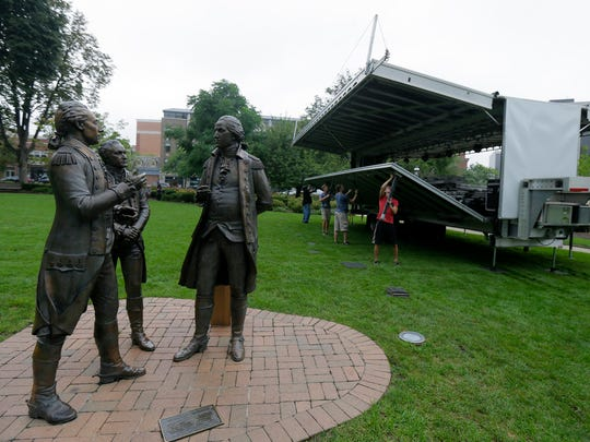 Stagehands from Circuit Lighting, Inc. of Green Brook set up the stage for the Morristown Jazz and Blues Festival on the Morristown Green in Morristown, NJ Friday August 18, 2017.