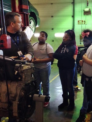 Jeff Sisk, TCAT director, teaches MentorU students about automotive technology in this 2015 file photo.