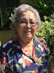 War survivor Cynthia Terlaje reflects on her experience during the WWII Japanese occupation, outside of her Asan home.