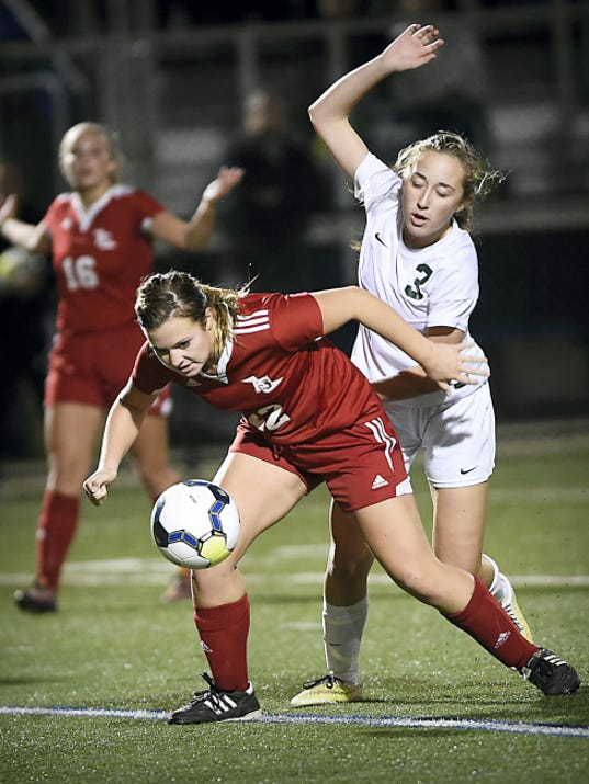 Annville-Cleona's Amanda Bates and Trinity's Theresa Durle battle for possession during a District Three Class A semifinal at Lower Dauphin Middle School on Monday.