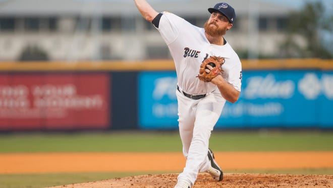 The Blue Wahoos Barrett Astin, shown pitching against the Mississippi Braves in a game in Pensacola, was dynamite last night on the road against the Braves in helping lead a doubleheader sweep.