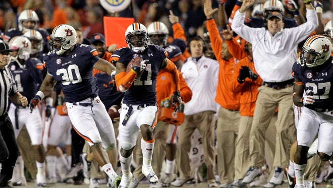 Nov. 30, 2013: Auburn's Chris Davis returns a missed field goal by Alabama for a game-winning touchdown  on the last play of the game.