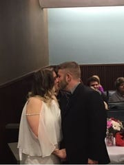 Jason Jackman and Lacey Hatfield kiss during their