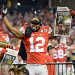 Ohio State Buckeyes cornerback Doran Grant (12) and Ohio State Buckeyes wide receiver Corey Smith (84) celebrate after beating the Oregon Ducks in the 2015 CFP National Championship Game at AT&T Stadium.