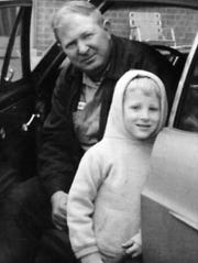 JC Bowman as a child with his father.