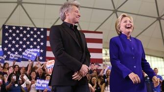 Democratic presidential candidate Hillary Clinton stands on stage with singer Jon Bon Jovi at a rally on June 1, 2016 in Newark, New Jersey.