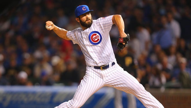 Jake Arrieta delivers a pitch during the first inning against the Pirates.