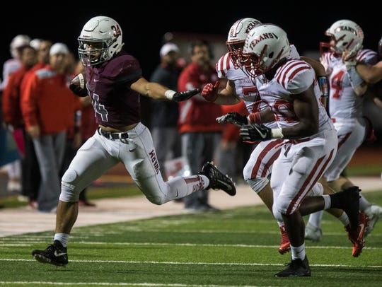 Flour Bluff's Devin Burlingame rushes the ball during
