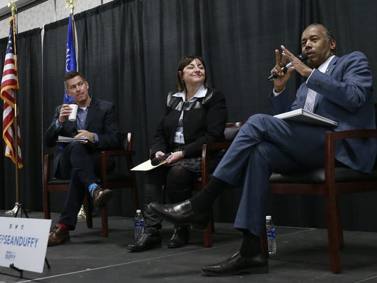 Panelists Secretary of the Department of Housing and Urban Development, Dr. Ben Carson, right, Wisconsin First Lady Tonette Walker, and U.S. Rep. Sean Duffy answer attendees' questions during the Hunger and Homelessness Summit Wednesday, Jan. 24, 2018, at the Central Wisconsin Convention and Expo Center in Rothschild.