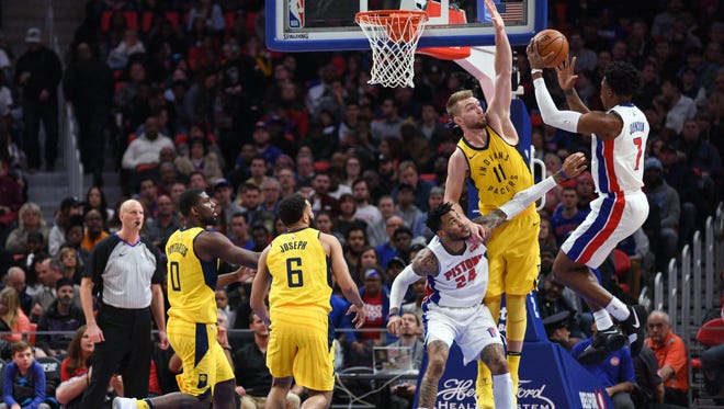 Detroit Pistons forward Stanley Johnson (7) goes to the basket and is fouled by Indiana Pacers center Domantas Sabonis (11) during the second quarter at Little Caesars Arena.