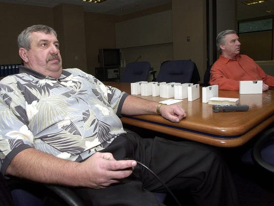 San Diego Chargers' general manager John Butler, left,